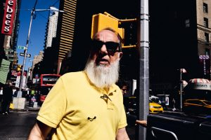 bearded guy with sunglasses and yellow polo Tomaso Baldessarini