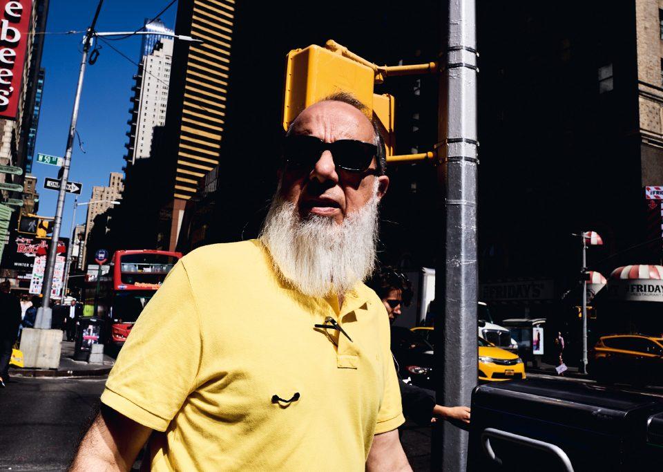 bearded guy with sunglasses and yellow polo Tomaso Baldessarini