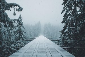train tracks into snow