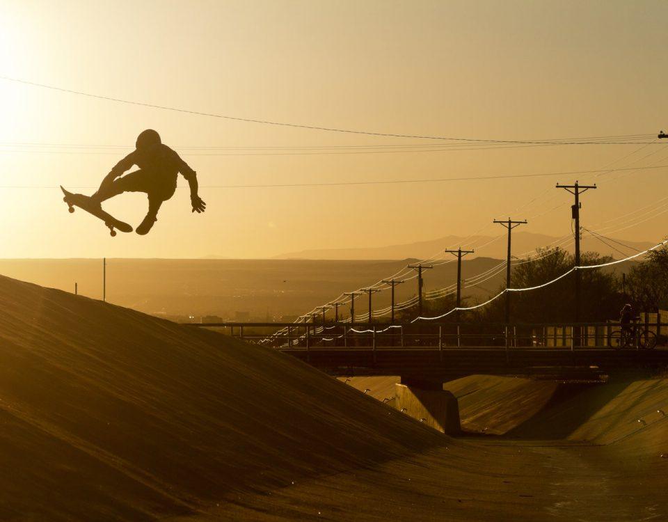 Skateboarder jump in air photo Max Dubler