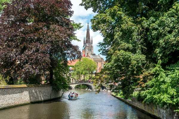 bridge and boat in Bruges Belgium