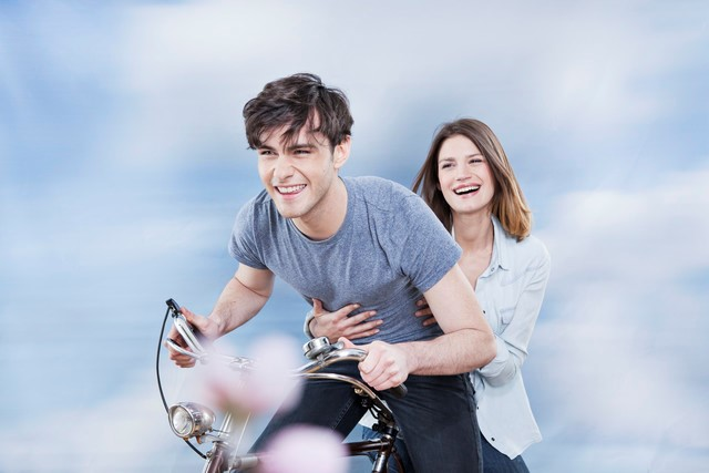 laughing couple on a bicycle