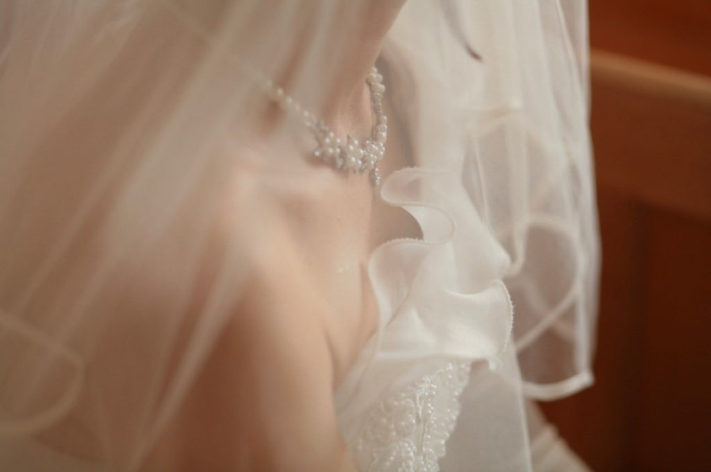 close up bridal jewellery on neck