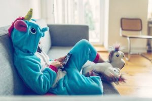 Blue unicorn onepiece playing phone