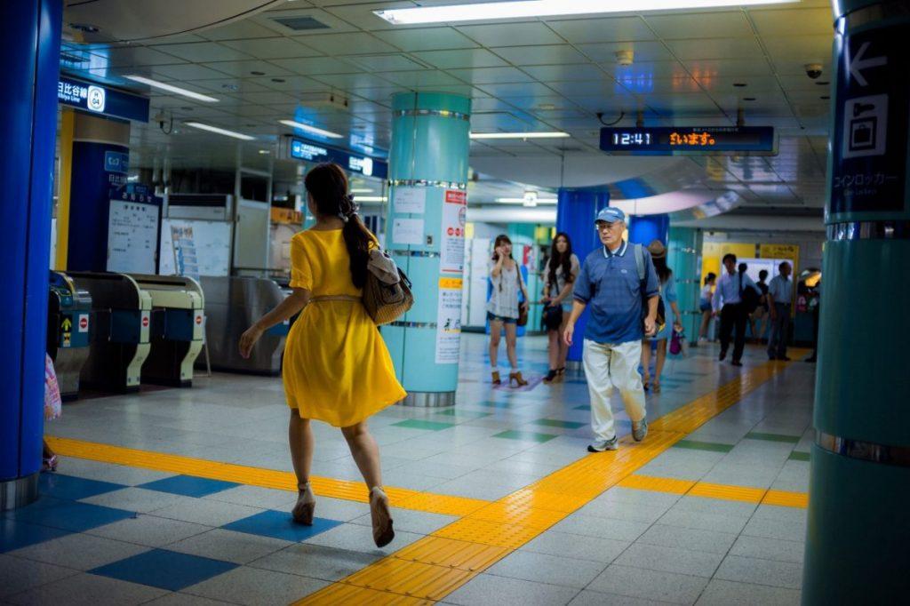 Lukasz Palka Tokyo Metro woman in yellow dress