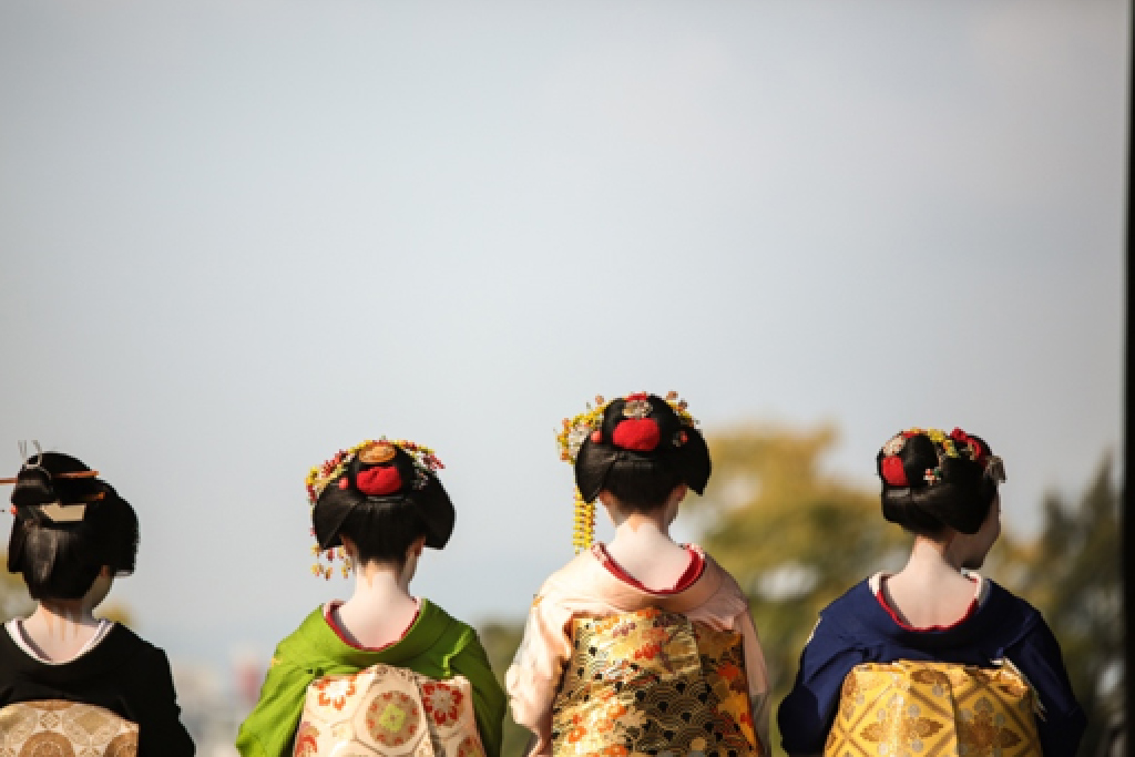 Image shows four geisha's from the back