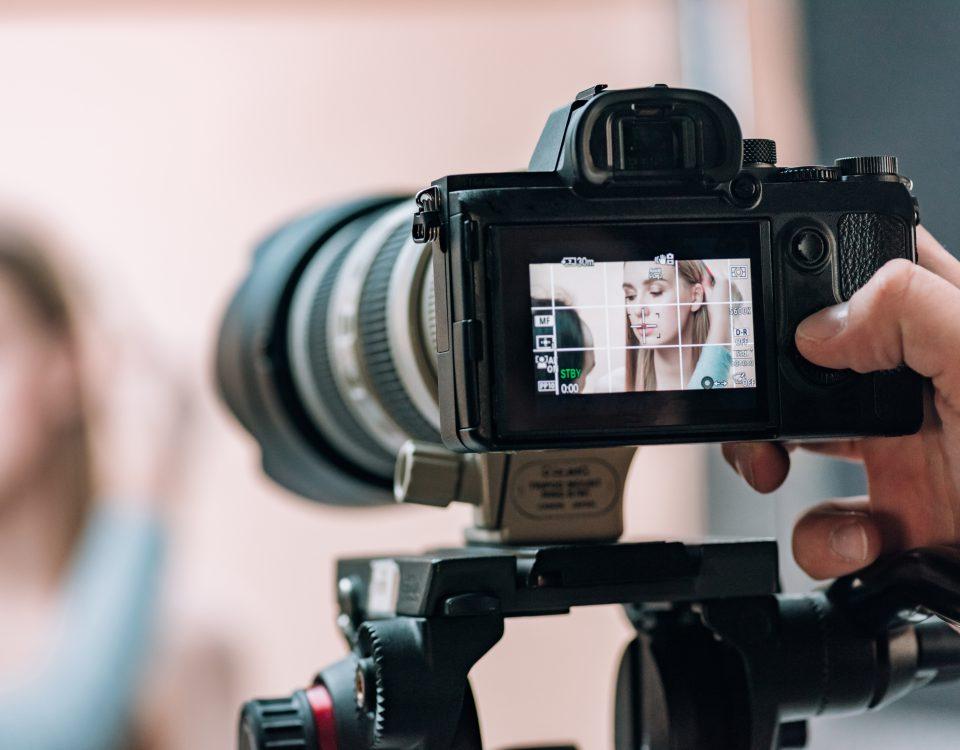 Selective Focus Of Beautiful Model On Camera Display In Photo Studio